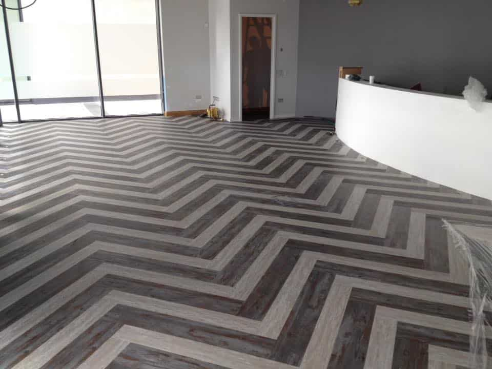 Herringbone pattern tiles on commercial tiling contract